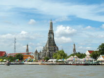 Wat Arun, in Bangkok, Thailand. The Temple of Dawn, Wat Arun, on the Chao Phraya river and  beautiful blue sky in Bangkok, Thailand Royalty Free Stock Images