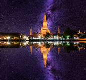 Wat Arun Buddhist religious places under milky way stars and space dust in the night sky, Bangkok, Thailand Stock Image