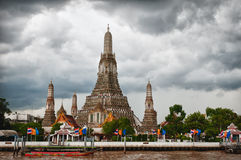 Wat Arun with clouded sky Stock Images