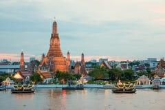 Wat Arun and cruise ship in night ,Bangkok city ,Thailand Stock Photo