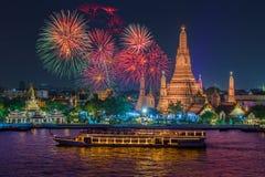 Wat arun and cruise ship in night time under new year celebration. Bangkok city ,Thailand stock photos