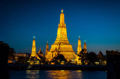Wat Arun The golden Temple on the blue background. Wat Arun is The most beautiful when open light in the Temple at twilight royalty free stock photo