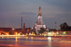 Wat Arun and light trail on Chao Phraya river Stock Image