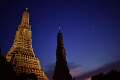 Wat Arun at night, Beautiful golden pagoda and lighting and dark night sky stock photography