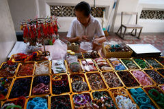 Wat Arun. Precious stone prayer beads vendor. Royalty Free Stock Photos