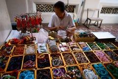 Wat Arun. Precious stone prayer beads vendor. Royalty Free Stock Photos