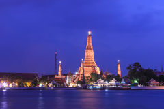 Wat Arun Rajwararam. The famous Wat Arun , perhaps better known as the Temple of the Dawn, is one of the best known landmarks and one of the most published Stock Photo