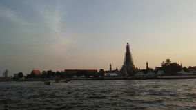 Wat Arun Ratchawararam Ratchawaramahawihan, Wat Arun, Temple of Dawn across Chao Phraya River during Sunset in Bangkok, Thailand. Royalty Free Stock Photography