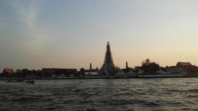 Wat Arun Ratchawararam Ratchawaramahawihan, Wat Arun, Temple of Dawn across Chao Phraya River during Sunset in Bangkok, Thailand. Stock Photo