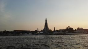 Wat Arun Ratchawararam Ratchawaramahawihan, Wat Arun, Temple of Dawn across Chao Phraya River during Sunset in Bangkok, Thailand. Royalty Free Stock Photo