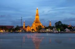 Wat Arun river side with Chao Phraya River in Bangkok at twiligh Royalty Free Stock Photos