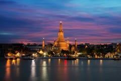 Wat Arun temple and Chao Phraya River at night in Bangkok, Thail Royalty Free Stock Photo