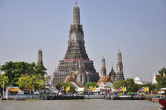 Wat Arun, a Bangkok landmark soaring into blue sky royalty free stock photography