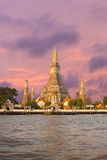 Wat Arun Temple Dawn Bangkok Sunrise Sky Vertical. Wat Arun, the Temple of Dawn, stands along the Chao Phraya river at morning sunrise with a fiery red sky in Royalty Free Stock Images