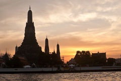 Wat Arun (Temple of the Dawn) in Bangkok during sunset Stock Images