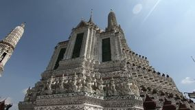 Wat Arun or Temple of Dawn is a Buddhist temple in west bank of the Chao Phraya river.  stock video