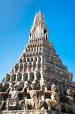 Wat Arun or Temple of Dawn over blue sky. Thai traditional Buddh Stock Photo