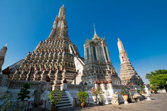 Wat Arun or Temple of Dawn over blue sky. Thai traditional Buddh Stock Photos