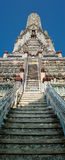 Wat Arun or Temple of Dawn over blue sky. Thai traditional Buddh Royalty Free Stock Image