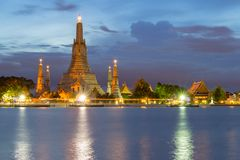 Wat Arun, The Temple of Dawn, at twilight. View across river. Bangkok, Thailand royalty free stock photos