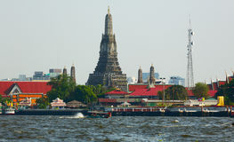 Wat Arun Temple on the Mae Nam Chao Phraya River (Eng. The river of Kings). Bangkok, Thailand. Stock Photography