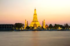 Wat Arun & x28;Temple& x29; Night time view and The Chao Phraya River in B. Angkok, Thailand royalty free stock photo