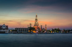 Wat Arun. The view of Wat Arun across Chao Phraya River in the evening Stock Images