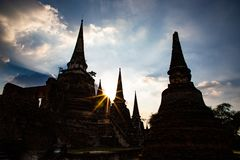 Wat Chai Wattanaram ruins silhouette with sun shining through stock photos