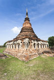 Wat Chang Lom. Surrounding Wall with Elephants of Wat Chang Lom in the Sukhothai Historical Park in Thailand Royalty Free Stock Images