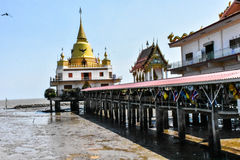 Wat Hong Thong with Long Bridge extend to the sea. Royalty Free Stock Photos