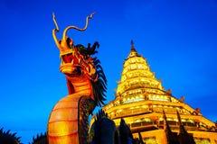 Wat Huai Pla Kung Temple at sunset in Chinag Rai, Thailand. Chiang Rai, Thailand. Wat Huai Pla Kung Temple at sunset in Chinag Rai, Thailand. Illuminated Dragon Royalty Free Stock Photo
