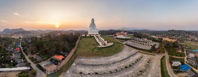 Wat Huay Pla Kang temple with Guanyin and church at sunset. Chiang Rai province. Aerial view of Wat Huay Pla Kang temple with Guanyin and church at sunset royalty free stock image