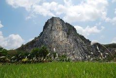 Wat Khao Chi Chan Buddha image in mountain Stock Image