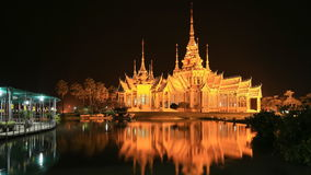 Wat Luang Pho Toh temple with water reflection in twilight time stock video footage