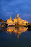Wat Luang Pho Toh temple with water reflection in twilight time, Stock Images