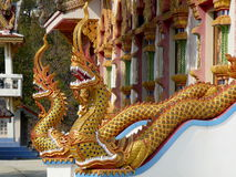 Wat in Mae Sariang, Thailand. Jeweled and golden Serpents outside of Wat in Mae Sariang, Thailand Royalty Free Stock Photos