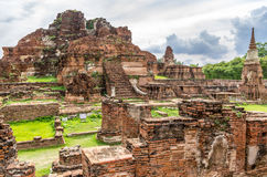 Wat Mahathat, a ruined temple in Ayuthaya, Thailand. The Ayutthaya historical park covers the ruins of the old city of Ayutthaya, Thailand. The park was Royalty Free Stock Image