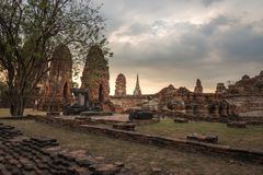 Wat Mahathat temple in cloudy day in Ayutthaya, Thailand. View of Wat Mahathat temple in cloudy day in Ayutthaya, Thailand Royalty Free Stock Photos