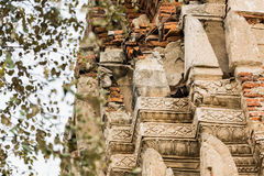 Wat Mahathat Temple Ruin, Ayuthaya, Thailand. Close up detail of the 700 years old craving brick of Wat Mahathat temple Royalty Free Stock Image