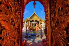Wat Ming Muang, Chiang Rai. Gold Gate entrance of thai lanna temple of Wat Ming Muang, Chiang Rai, Thailand Royalty Free Stock Image