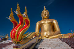 Wat Muang in Ang Thong. Wat Muang located Tambon Huataphan. Have Buddhist temple surrounded by lotus petal the biggest in the world Stock Photography