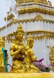 Golden sculptures at fountain in Wat Pha Nam Yoi Thailand. Wat Pha Nam Yoi golden sculptures at the fountain. Phra Maha Chedi Chai Mongkol Pagoda, Wat Pha Nam Royalty Free Stock Photos