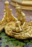 Golden sculptures at fountain in Wat Pha Nam Yoi Thailand. Wat Pha Nam Yoi golden sculptures at the fountain. Phra Maha Chedi Chai Mongkol Pagoda, Wat Pha Nam Stock Photography