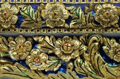 Wat Pho ceramic. Wat Pho gold glass in Bangkok Stock Images