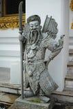 Wat Pho Chinese stenförmyndare, Bangkok, Thailand fotografering för bildbyråer