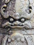 Wat Pho face. Demon's face at Wat Pho Bangkok royalty free stock photo