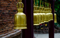 Wat Pho Kao Ton Bells. The bells at Wat Pho Kao Ton near Singburi in central Thauland. The temple wall can also be seen here Royalty Free Stock Photos