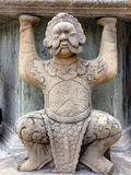 Wat Pho statue. Supporting statue from Wat Pho in Bangkok stock image