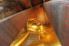 Wat Pho the Temple of the Reclining Buddha. One of the largest temple complexes in the city and famed for its giant reclining Buddha that measures 46 metres royalty free stock images