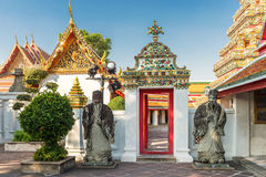 Wat Pho Temple Statues, Bangkok, Thailand Lizenzfreie Stockbilder